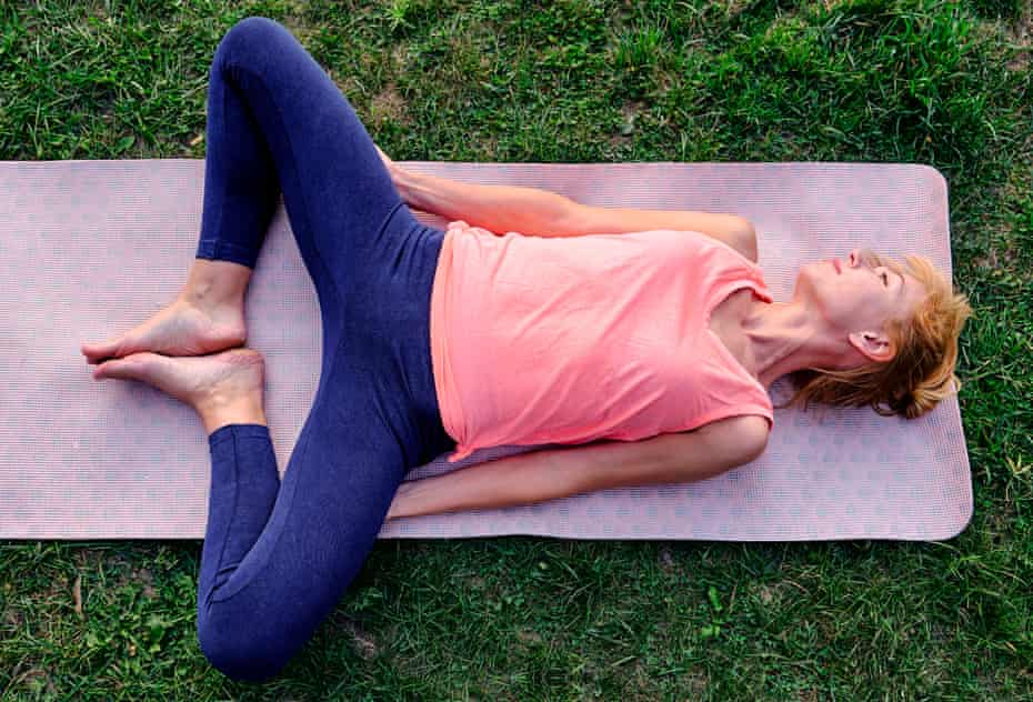 A woman doing a pelvic stretching exercise