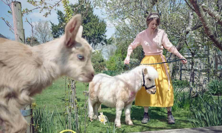Animal magic: Rebecca Schiller with two of the creatures with whom she shares her smallholding in Kent.