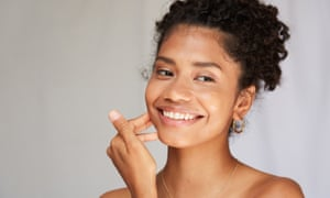 Young beautiful african american woman in skincare and beauty routine studio shoot.